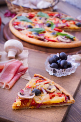 Pizza with tomato, salami and olives