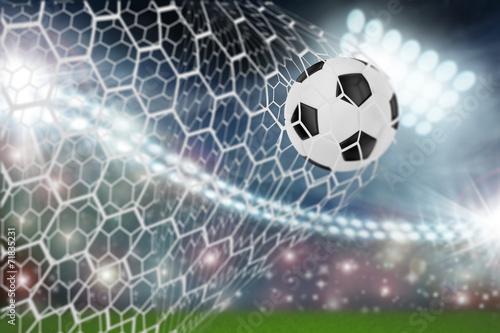 soccer ball in goal net - 71835231