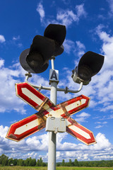 railroad crossing sign and semaphore