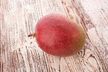 Mango fruit on wood