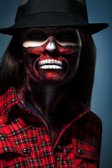 Halloween portrait of woman with face art