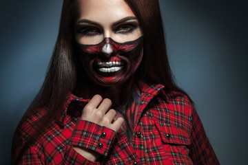 Horizontal portrait of adult girl with scary face art for hallow