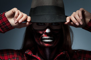 Horizontal portrait of female with scary face art for halloween
