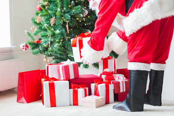 close up of santa claus with presents