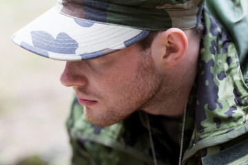 close up of young soldier in military uniform