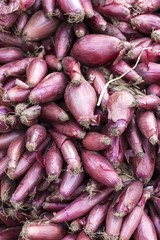 Red onions sold in traditional market for vegetables