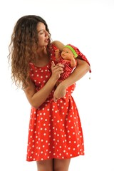 Teenager girl with belonde baby doll isolated white background