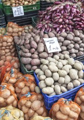 Red potato and onion for sale in a supermarket