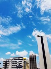 Blue sky above buildings