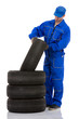 Motor mechanic with a tyre