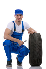 Friendly car mechanic with  tires