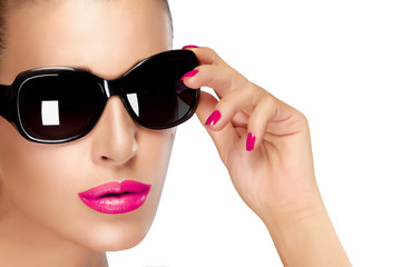Beautiful Model in Black Fashion Sunglasses. Makeup and Manicure