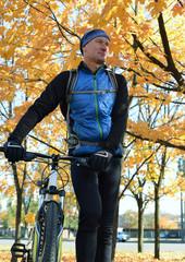 Cyclist  in autumn park