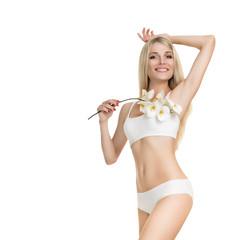 Female waxing armpit in a beauty salon. Depilation. Epilation