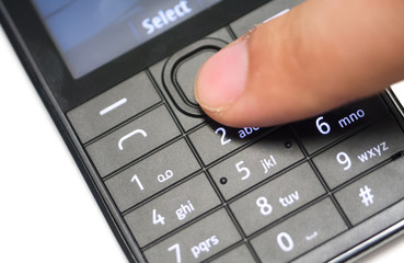 Finger pushing cell phone's navigation button