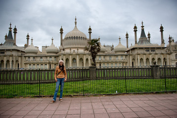 Woman standing in front of Royal Pavilion in Brighton