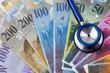 Schweizer Franken und Stethoskop