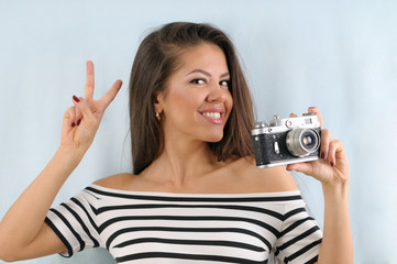 attractive cute happy emotional woman with vintage photo camera