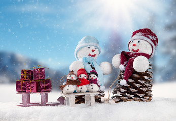 Winter snowy scenery with snow men