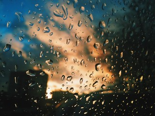 Drops on the window. Rain in the city