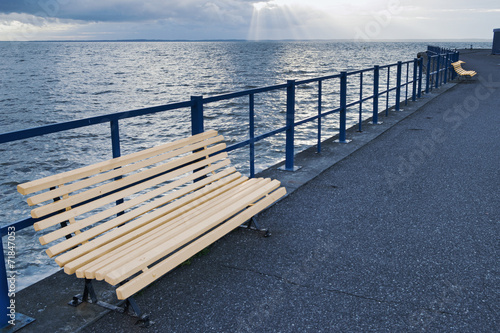 A wooden bench on the pier. - 71847053