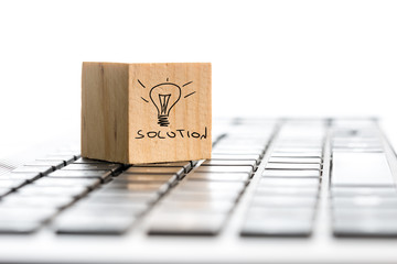 Solution and a hand-drawn illuminated light bulb