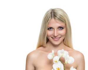 Adult woman with beautiful face and white flowers