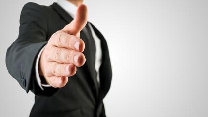 Businessman Showing Handshake Gesture