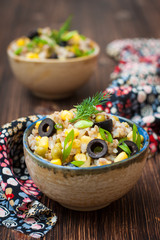 buckwheat porridge with corn, green peas and olives
