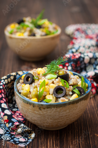 canvas print picture buckwheat porridge with corn, green peas and olives