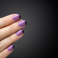 Beautiful manicure, polish is a violet color.