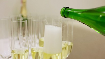 Pouring champagne in wine glass