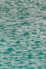 Rain falling into a swimming pool