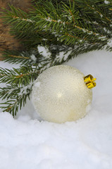 Christmas background with shiny ball in the snow on a background