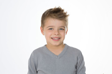 blond cheerful kid on isolated background
