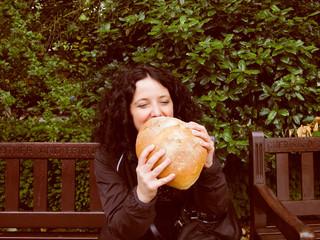 Girl eating bread