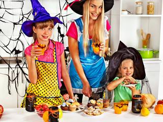 Family preparing halloween food.