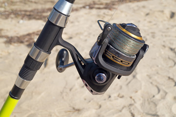 Fishing rod and reel on the beach