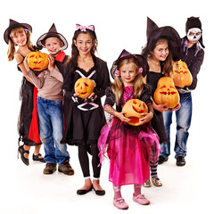 Halloween party with group kid holding carving pumpkin