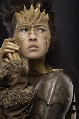 Woman in golden fantasy armour
