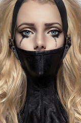 Portrait of blonde woman in BDSM neck collar