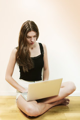 Young woman busy on laptop