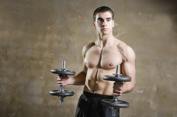 Man training shoulder muscles exercises in old gym