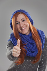 Woman with Red Hair Making Thumbs Up Hand Gesture