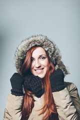 Smiling Woman with Red Hair Wearing Winter Clothes
