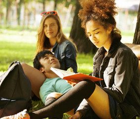 cute group of teenages at the building of university with books