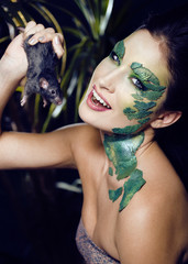 woman with creative make up like snake and rat in her hands,