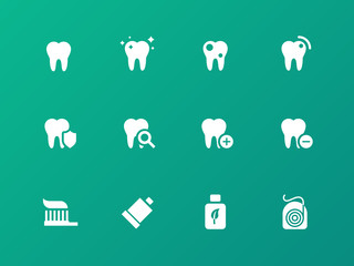 Tooth, teeth icons on green background.