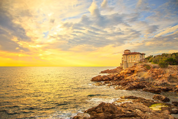 Boccale castle landmark on cliff rock and sea on warm sunset. Tu