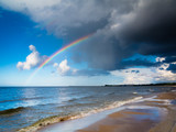 Fototapety landscape view on sky with rainbow at sea.